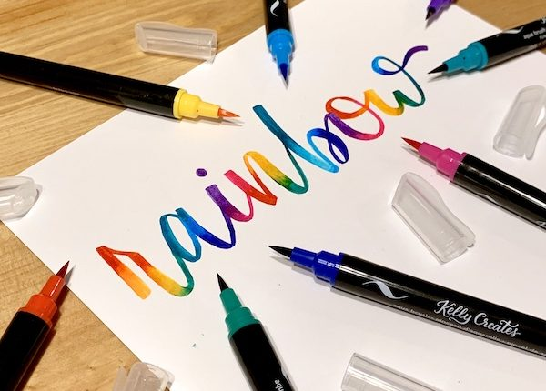 Pretty rainbow hand lettering and calligraphy using brush pens and water for a blending effect www.kellycreates.ca