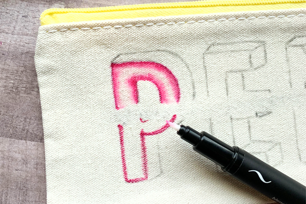 Amazing hand lettering on a canvas pen pouch pencil case tutorial www.kellycreates.ca