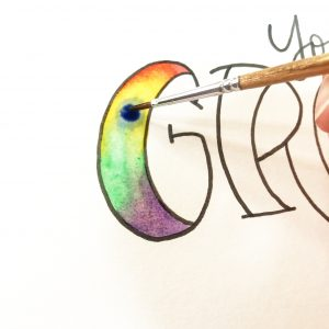 Groovy lettering tutorial with rainbow watercolor technique