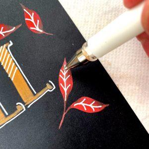 white pen and metallic pen lettering on black paper www.kellycreates.ca